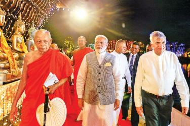 Indian Prime Minister Narendra Modi who arrived in the country last afternoon later visited the Gangaramaya Temple in Colombo to open the 'Gangaramaya Vesak Zone. Prime Minister Modi was accompanied by Prime Minister Ranil Wickremesinghe. Chief Incumbent of the Gangaramaya Temple Ven. Galaboda Gnanissara Thera and Chairman of the Gangarama Dayakasaba Ranjith Wijewardene welcomed the Indian Prime Minister. Ven. Galaboda Gnanissara Thera also conducted religious observances with Prime Minister Modi in attenda
