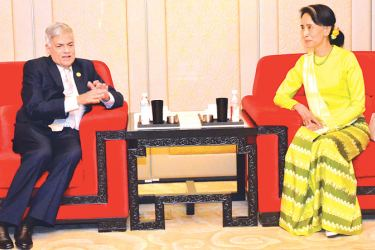 Myanmar's State Counsellor and Leader of the National League for Democracy Aung San Suu Kyi and Prime Minister Ranil Wickremesinghe having discussions on the sidelines of the 'One Belt, One Road' summit in Beijing, China yesterday.