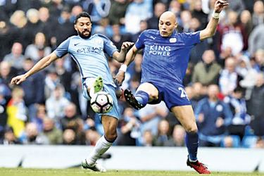 Manchester City's Gael Clichy in action with Leicester City's Yohan Benalouane in their Premier League match at Etihad Stadium on Saturday.