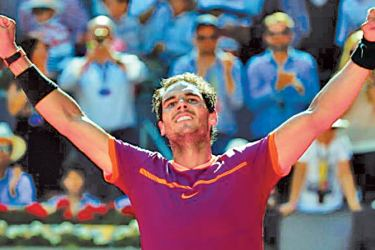 Rafael Nadal celebrates at the end of his match against Novak Djokovic of Serbia in the men's singles semi-finals of the Madrid Open on Saturday.