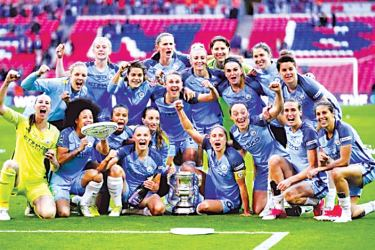 Manchester City players celebrate with the trophy after winning the Women's FA Cup Final.