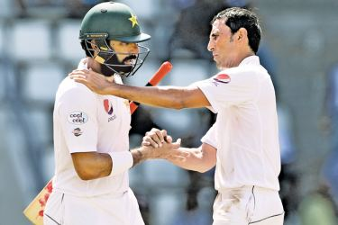 Pakistan captain Misbah-ul-Haq is consoled by team mate and fellow retiree Younis Khan after he was dismissed for two when batting for the last time before retirement on the fourth day of the third and final Test against West Indies at Windsor Park in Dominica on Saturday. AFP