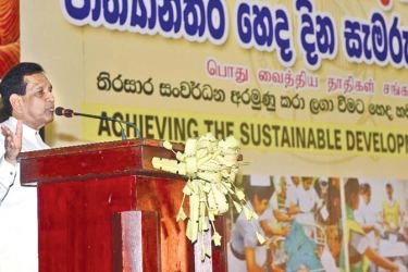 Health  Minister Dr. Rajitha Senaratne addresses the nurses during  International Nurses' Day held at the Colombo Royal Collage Theatre  recently.