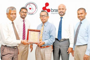 The presentation of a plaque of appreciation to Brandix - Dr Senerath Jayasekara, Senior Consultant and Transfusion Physician and Dr Nilantha Liyanage, Medical Officer In-charge of the Donor Section of the NBTS with Ishan Dantanarayana, Group Chief People Officer, Anuk De Silva, DGM - Corporate Communications and Anushka Gunasoma Assistant Manager - Corporate Communications of Brandix.
