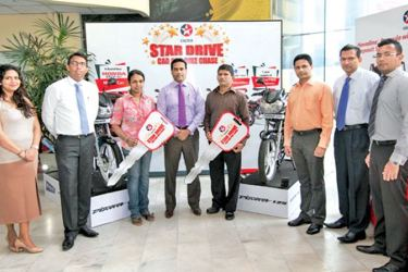 "The winners of the first round of ""Caltex Star Drive – Car and Bike Chase""  receiving their awards."