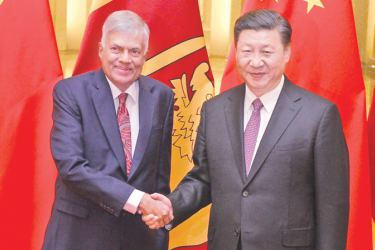 Prime Minister Ranil Wickremesinghe with Chinese President Zi Jingping on the sidelines of the One-Belt-One-Road conference held in Beijing, China on Monday.