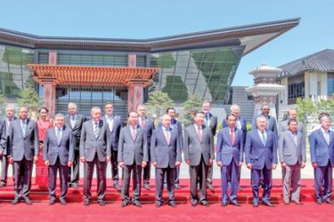 """Heads of State and leaders,including Prime Minister Ranil Wickremesinghe attending the Belt and Road Initiative—or """"One Belt, One Road"""" (OBOR) pose for a group photograph at the conclusion of the Summit. Picture courtesy Prime Minister's Media"""