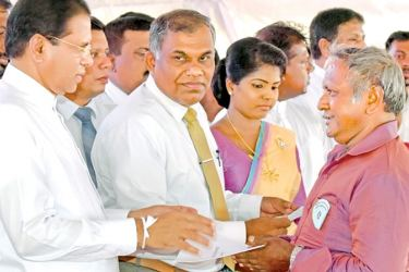 President Maithripala Sirisena participating at the ceremony to offer 10, 000 deeds to the settlers of the Mahaweli C and B zones held on May 15 at the Vilayaya Maha Vidyalaya, Aralaganwila.