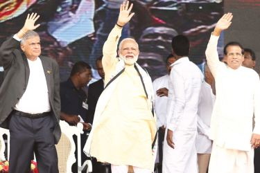 President Maithripala Sirisena, Prime Minister Ranil Wickremesinghe and Indian Prime Minister Narendra Modi  greeting the crowd at a public rally in Dickoya last Friday. Picture by Rukmal Gamage