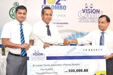 Colombo Championship principal sponsor Vision Care's General Manager, Harsha Maduranga (left extreme) and its Managing Director Janaka Fonseka handing over the sponsorship cheque to SLTA playing section president Ravi Perera (extreme right). Picture by Shan Rambukwella