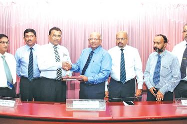 Signing MoU of 'Kelani Saviya'- Prof. Luxman Wijeweera, Deputy Vice Chancellor, Anil Munasinghe, General Manager Sales, Mahinda Saranapala, Director/CEO, Kelani Cables PLC, and Prof. Upul B Dissanayake, Vice Chancellor,  University of Peradeniya, Upul Mahanama, General Manager, Operations, Prof. Manjula Fernando, Head of Electrical and Electronic Engineering Dept and Dr. G.R. Herath Actg. Dean, Faculty of Engineering.