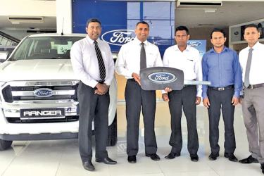 The fleet of Ford Ranger Double Cabs gifted to the National Housing Authority.