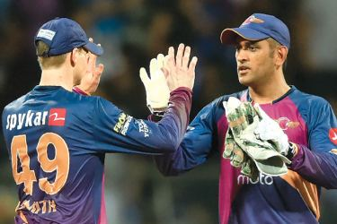 Rising Pune Supergiant captain Steven Smith greets teammate Mahendra Singh Dhoni after winning the first 2017 Indian Premier League (IPL) Twenty20 Qualifier 1 cricket match between Mumbai Indians and Rising Pune Supergiants at The Wankhede Stadium in Mumbai on May 16. AFP