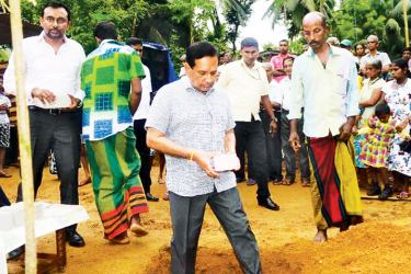 Health Minister Dr. Rajitha Senaratne lays the foundations stone for a new house for a flood affected family from ​Bulathsinghela.
