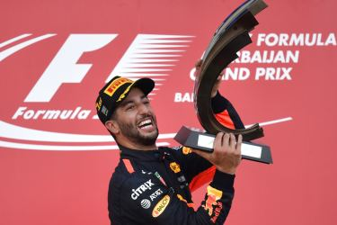 Winner Red Bull's Australian driver Daniel Ricciardo celebrates with the trophy after the Formula One Azerbaijan Grand Prix at the Baku City Circuit in Baku on June 25. AFP