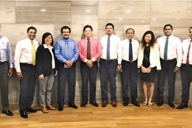 Laugfs Holdings Group Chairman, W.K.H. Wegapitiya, Managing Director, Thilak De Silva, Fujitsu Group Executive Vice President, Hiroyuki Okamoto, together with the Laugfs International team at the launching ceremony.