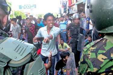 Demonstrations against SAITM by University students near Health Ministry. Picture by Sudam Gunasinghe