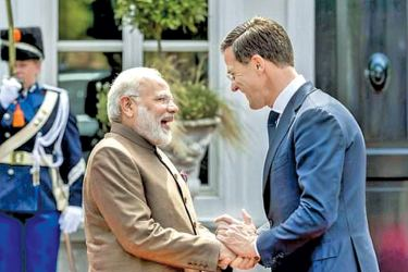 Dutch Prime Minister Mark Rutte (R) shakes hands with Indian Prime Minister Narendra Modi, as the two met to discuss cultural cooperation between their countries, which are major trading partners.- AFP