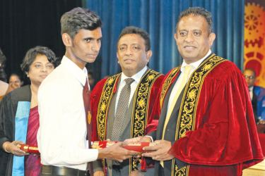 A students receiving his certificate from the Minister.