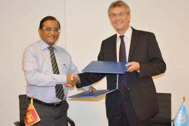Science, Technology and Research Ministry Secretary Udaya Seneviratne exchanging the partnership agreement with UNDP Sri Lanka Country Director Jorn Sorensen.