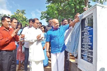 Minister Duminda Dissanayake unveiling the new anicut. Picture by Anurdhapura Central Group Corr.