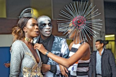 Models present creations during a fashion show at Africa's biggest horse race at Durban on Saturday.