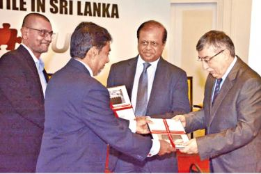 Sunil Amarawansa, Director of Chrysotile Information Centre, hands over the report titled 'Socio Economic Impact of the Potential Prohibition of Chrysotile in Sri Lanka' to Russian Ambassador to Sri Lanka, Alexander A. Karchava, as  Minister Susil Premajayantha and  Roshan Madawela, CEO of Research Intelligence Unit (RIU) look on