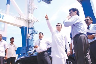Minister Mahinda Samarasinghe explaining an issue to the officials  during his inspection tour at the Hamabantota Magampura Port.