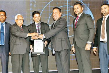 Harsha Kurukulasuriya - AGM Operations and Credit Administration of Pan Asia Bank is seen accepting the award. Also in the picture from left : Channa de Silva - General Manager/CEO (LankaClear (Pvt) Ltd),  Sarath Silva - Former Chairman (LankaClear (Pvt) Ltd,  Sunimal Weerasooriya - Former General Manager/CEO (LankaClear (Pvt) Ltd),  Harsha Kurukulasuriya - AGM Operations and Credit Administration of Pan Asia Bank,  Charitha Karunarathna - Manager Products & ATL Communications of Pan Asia Bank and Asanka Th