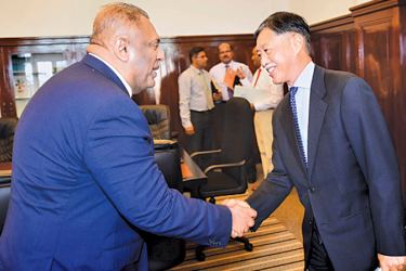 Finance and Media Minister Mangala Samaraweera receiving Japanese Ambassador to Sri Lanka Kenichi Suganuma at the Finance Ministry on Monday.