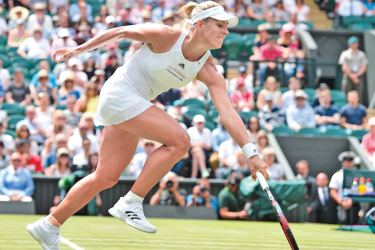 Germany's Angelique Kerber returns against US player Irina Falconi during their women's singles first round match on the first day of the 2017 Wimbledon Championships at The All England Lawn Tennis Club in Wimbledon, southwest London, on July 3,  AFP