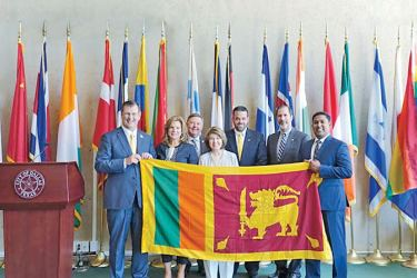 The presentation of the national flag of Sri Lanka to the City of Dallas by Susantha Halamba.