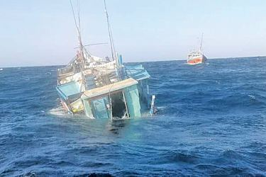 The ill-fated boat, Faik 2, sinking after the collision. Picture by Lunama Group corr.