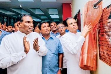 President Maithripala Sirisena unveiling the plaque to open the Sri Lanka Freedom Party Trade Union Federation office at the SLFP headquarters in Colombo yesterday.