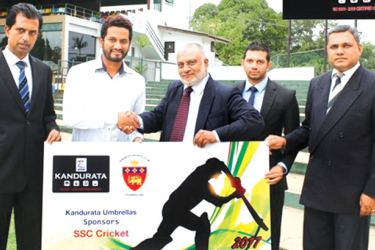 SSC cricket captain, Dimuth Karunaratne (second from left) and SSC cricket chairman Samantha Dodanwela (left extreme) receiving the sponsorship cheque from Kandurata Umbrella's DGM- Marketing, Riza Thahir (centre). M. M. Rizlan (Finance Manager - Kandurata Umbrella) and Lakshman Nanayakkara (Senior sales manager - Kandurata Umbrella) are also present.
