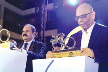 SLT Chairman Kumarasinghe Sirisena (left) and SLT Group CEO Dileepa Wijesundara unveiling  the main trophies during a media briefing at the Cinnamon Grand Hotel. Picture by Chinthaka Kumarasinghe