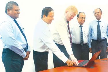 M.S.I. Peiris Non-Executive Director,  Channa De Silva Independent Non-Executive Director,  R.S.W. Senanayake Managing Director and Chief Executive Officer, S. Jeyavarman  Independent Non-Executive Director   and  H.M. Hennayake Bandara Independent Non-Executive Director, launching the corporate website of K Seeds Investments.