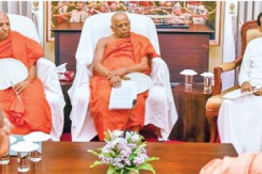 The Mahanayake Theras of the Asgiriya, Malwathu and Amarapura Chapters meeting President Maithripala Sirisena at the President's House in Kandy  yesterday.Buddha Sasana and Justice Minister Wijeyadasa Rajapakshe and  Central Province Chief Minister Sarath Ekanayake look on.  Picture by President's Media Unit
