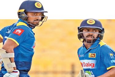 Sri Lanka opening pair Danushka Gunathilaka and Niroshan Dickwella who laid the platform for their team's eight wicket win with a double century partnership in the third ODI against Zimbabwe at the Mahinda Rajapaksa Stadium in Hambantota yesterday. AFP