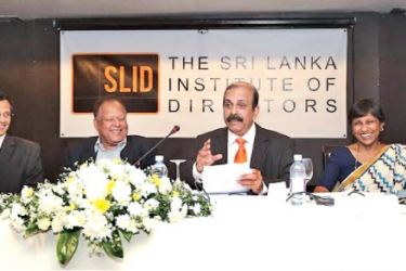 Minister Dr. Sarath Amunugama with SLID officials