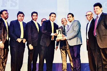 LAUGFS Holdings Group IT team receiving the award at the award ceremony