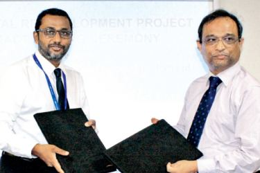 Ahmed Afaal, Managing Director, ADK Hospital and Saliya Lenaduwa, Chief Executive Officer ECL, signing the agreement.
