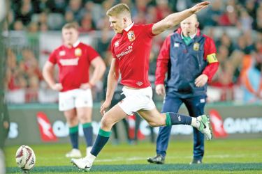 British and Irish Lions inside centre Owen Farrell kicks a penalty during the third rugby union test match against New Zealand All Blacks at Auckland on Saturday. - AFP