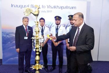 SriLankan Airlines Chief Commercial Officer Siva Ramachandran lighting  the oil lamp at Bandaranaike International Airport minutes before the new flight set off to Visakhapatnam