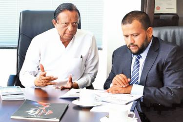 Minister of Tourism Development, John Amaratunga in conversation with Minister of Commerce and Industry, Rishad Bathiudeen.