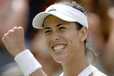 Spain's Garbine Muguruza celebrates beating Germany's Angelique Kerber during their women's singles fourth round match on the seventh day of the 2017 Wimbledon Championships at The All England Lawn Tennis Club in Wimbledon, southwest London, on July 10. AFP