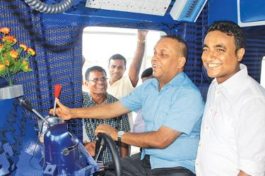 Minister Mahinda Amaraweera launching the first 55-ft multi-day fishing vessel  at Negombo Fisheries Harbour.
