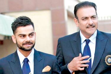 Ravi Shastri India's coach till 2019 World Cup (right) with Indian captain Virat Kohli