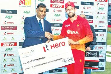 Zimbabwe's Craig Ervine  receiving the 'Hero of the Match' award from Channa Pathirana, Deputy Director of Abans representing Hero Motocorp at the 4th ODI versus Zimbabwe played in Hambantota on July 8.