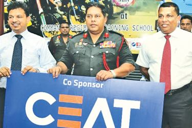 Regimental Colonel of Commando Regiment, Maj. Gen. Ralph Nugera (centre) receiving the sponsorship cheque from CEAT Sri Lanka's Deputy General Manager (Marketing), Bishri Latiff. SLARDAR president Nishan Wasalathanthriis also present (right extreme). Picture by Rukmal Gamage